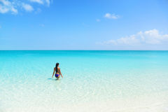 Beach holiday bikini woman swimming in blue ocean Stock Photo