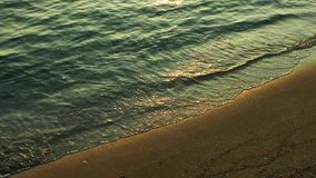 Beach Holiday Concept. Sand and Smooth Waves on Seaside and Sun Reflection stock video footage
