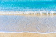 Sand beach sea with soft waves, summer holiday background. Beach holiday sea, soft waves at sand shoreline, summer travel background texture concept royalty free stock image