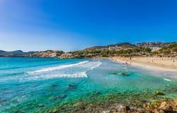 Beach holiday at seaside of Paguera on Majorca, Spain Balearic Islands. View of Platja de Tora in Peguera, beach Mallorca island, Mediterranean Sea royalty free stock photos