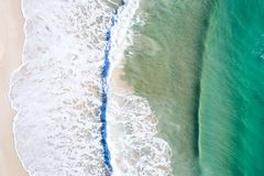 Beach holiday top view. Beautiful beach from above with nice blue water royalty free stock photos