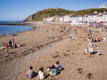 Seaside Beach Holiday in Wales, UK. People enjoying themselves on the beach at the seaside resort of Aberystwyth in  Ceredigion, Wales, UK Royalty Free Stock Photos