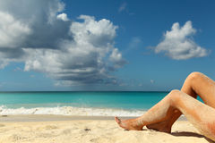 Beach holidays. Background picture with sandy legs stock image