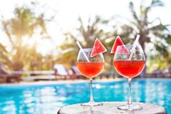 Beach holidays background with two cocktails near swimming pool in luxurious hotel. Tourism and vacation stock photo