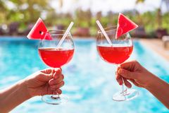 Beach holidays in hotel resort, couple drinking cocktails stock images