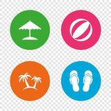 Beach holidays icons. Umbrella and sandals. Stock Photography