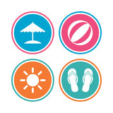 Beach holidays icons. Umbrella and sandals. Royalty Free Stock Images