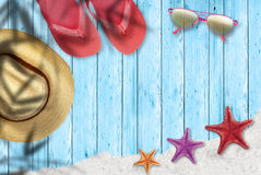 Beach holidays and relax. Starfish on sand, wooden floor, summer vacations Stock Photo