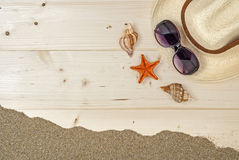 Beach holidays and relax. Starfish on sand, wooden floor, summer vacations shells Stock Photo