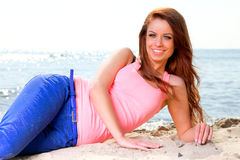 Beach holidays woman enjoying summer sun sand looking happy Royalty Free Stock Images