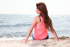 Beach holidays woman enjoying summer sun sitting sand looking ha. Beach holidays woman enjoying summer sun sitting in sand looking happy at copy space. Beautiful Stock Image
