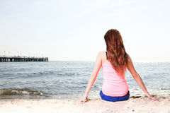 Beach holidays woman enjoying summer sun sitting sand looking ha Royalty Free Stock Photography