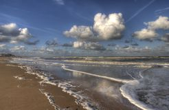 Beach in Holland. With beautiful clouds stock photo