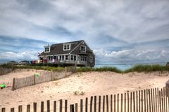 New England Beach Front House Rhode Island USA. Beach home in the sand dunes of Rhode Island, USA. Summer vacation memories stock images