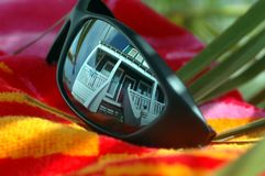 Beach Home in Sunglasses Reflection Stock Photos