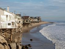 Beach Homes. A row of beach front homes enjoying the warm California sun Royalty Free Stock Photo