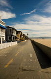 Beach homes and walkway. Row of beach homes with a divided walkway along the sand Royalty Free Stock Photography