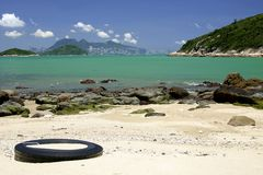 Beach with Hong Kong skyline Stock Images