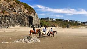 Beach Horse Riding. On the beautiful Oregon Coast and ocean trails Stock Photos