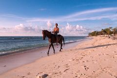 Beach horse-riding. In summertime Stock Photo