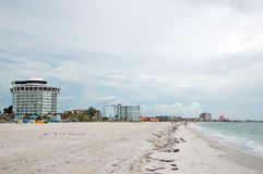 Beach with hotel. Beachfront hotel and white sand Royalty Free Stock Image