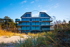 Beach hotel or house. Luxurious house or hotel on beach, Baltic shore on autumn day, Poland Royalty Free Stock Photos