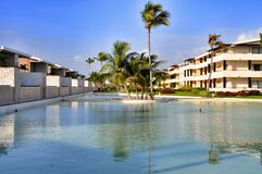 Beach Hotel Resort Swimming Pool. Surrounded by palm trees Royalty Free Stock Photos