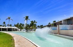 Beach Hotel Resort Swimming Pool. Surrounded by palm trees Stock Image