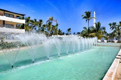 Beach Hotel Resort Swimming Pool. Surrounded by palm trees Royalty Free Stock Photo