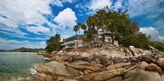 Beach hotels and rocks - Thai landscape Stock Images