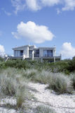 Beach House. Rising above white sand beach dunes, Australia Royalty Free Stock Photography