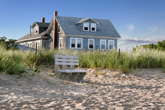 Beach house. New England beach cottage, overlooking the dunes and the beach royalty free stock images