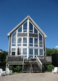 Beach House. A house on the beach on a clear, summer's day royalty free stock photo