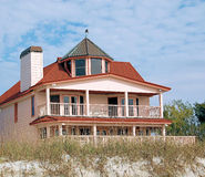Beach House. Over looking the sand and water Stock Photo