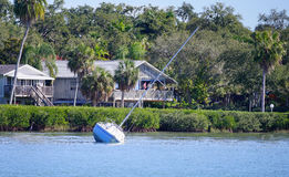 Beach house. And an abadoned ship taken in the tampa bay, Florida Stock Image
