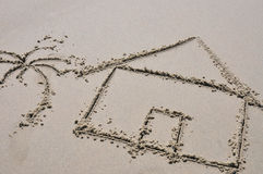 Beach house concept drawn in the sand Stock Image