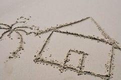 Beach house concept drawn in the sand. Beach house with palm tree drawn in the sand Stock Image