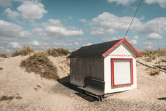 Beach house in Denmark in sunny weather with white clouds stock photography