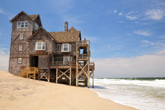 Beach house on eroded coast Royalty Free Stock Images