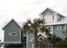 Beach house green. Vacation beach house green with palm trees Stock Photos