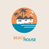 Beach house logo. Seaside beach logo with houses and palms Royalty Free Stock Image
