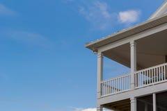 Verando porch set against a blue sky. A beach house near the Atlantic Coast has balconies overlooking the ocean Stock Photos