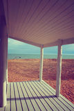 Beach house porch white vintage filter background Stock Image