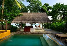 Beach house with private swimming pool Royalty Free Stock Images