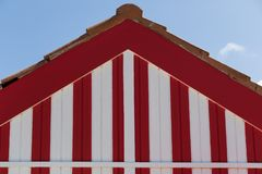 Beach house with red and white stripes stock image
