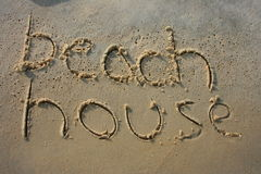 Beach House in sand. Beach House written in the sand Royalty Free Stock Image