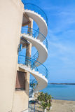 Beach House. A beach house with spiral stairs outdoors Royalty Free Stock Photo