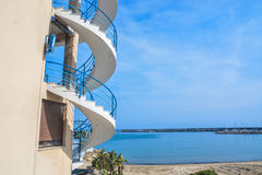 Beach House. A beach house with spiral stairs outdoors Royalty Free Stock Image
