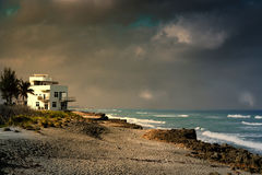 Beach house at storms end Royalty Free Stock Images