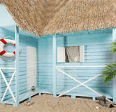 Beach house with turquoise thatched roof Stock Image